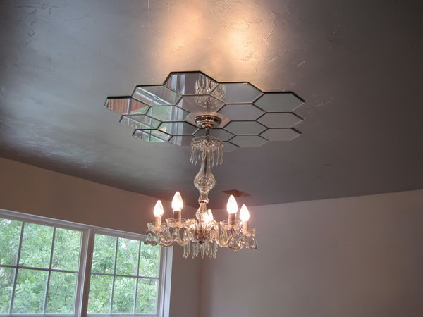 Mirrored Ceiling Medallion. This mirrored ceiling medallion looks so harmonious with the whole style of the bedroom, plus adds more elegance. With little imagination, you can make one by yourself for about $30 out of candle plates from Hobby Lobby.