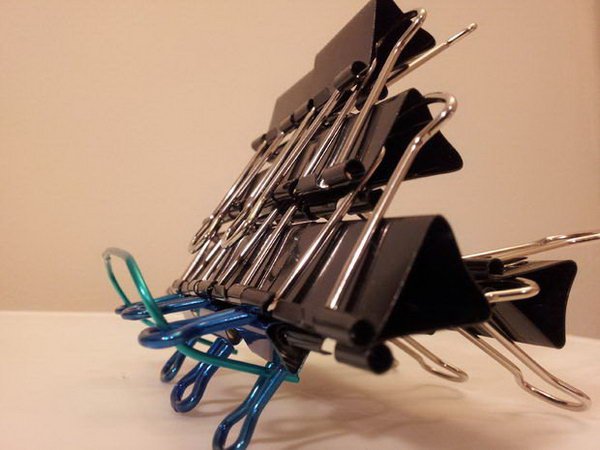 DIY binder clip iPad stand. This is a new usage for your binder clips. A binder clip iPad stand is simple to build and very stable.