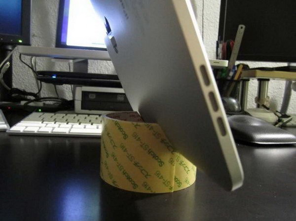 DIY tape roll iPad stand. This iPad stand is an easy one to make too. All you need is just a tape roll and a knife.You need to cut out the tape roll following the picture. But for stability, I advise you put a stand to one side of the centerline.