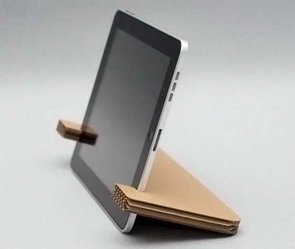 DIY Cardboard iPad Stand. We have so many cardboard boxes. Everything we buy comes in a cardboard box. Next time,do not throw away them after you open a package, you can get a new iPad stand just by using a scissor to make some cuts and clips to the cardboard box .