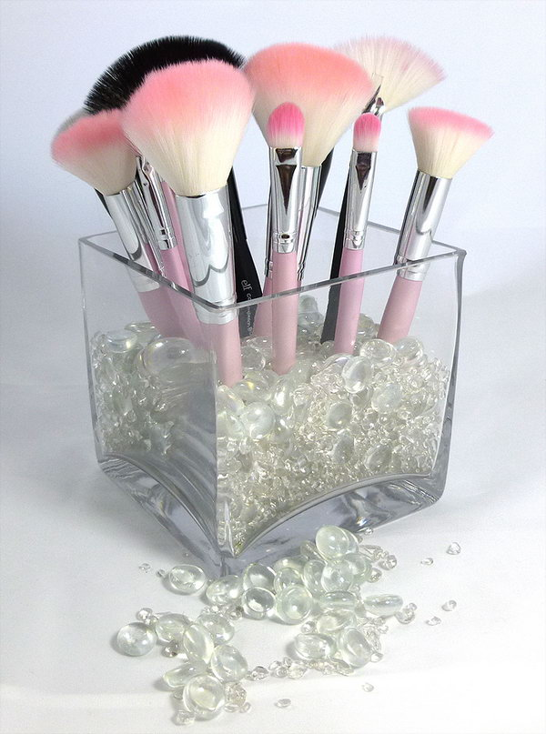 Beautiful makeup brushes holder. Get a glass cup and decorate it with some beautiful river rocks and stones. A new makeup brushes holder burnt out.