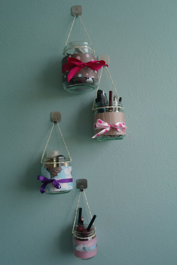 Makeup Organizer Hanging Jars .Decorate the common jars with beautiful fabric or colored ribbons, then hang them up with a good amount of strings. New hanging makeup kits born out .So simple but incredible cute.