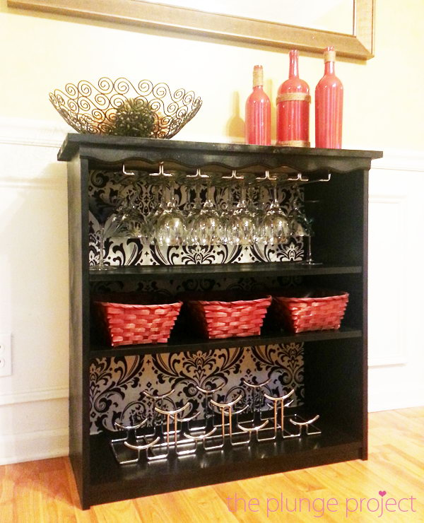 DIY Classy Wine Bar from an Old Bookshelf. It's a creative way to recycle an old bookshelf as a classy wine bar for your home. Get the tutorial here.