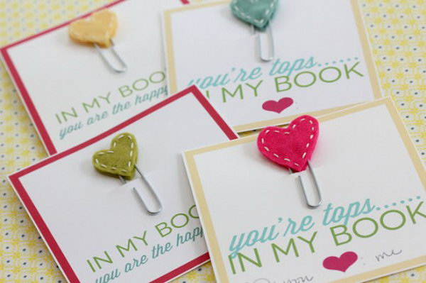 Adorable Stitched Heart Bookmarks. Use paperclips, white embroidery thread and colorful fabric to make these adorable stitched heart bookmarks as perfect gifts to all the book lovers in your life. See the details here.