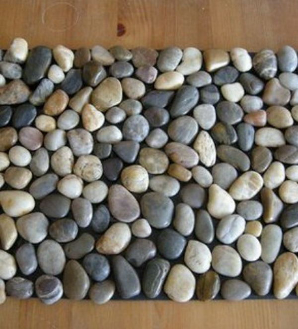 DIY Pebble Bath Mat. This one takes a lot of patience to complete, but you can do it and it is a far cry cheaper than paying someone else to do it or buying the tile from a tile store. It is ideal to put in the bathroom to prevent the slipperiness. The instruction is here.