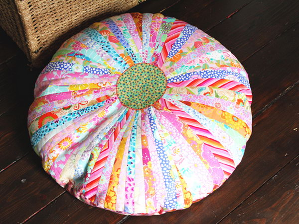 Beautiful DIY Floor Cushion. Join strips of the fabric with beautiful pattern in bright color, press the seams. Place a contrasting fabric in the center to make the cushion top look like a pretty flower.