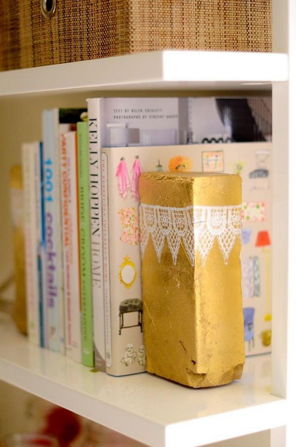 Brick Book Ends. Spray paint to add the gold color for the brick, decorate it with trims of lace or other fabric for a glamorous, feminine outlook to add up the beauty for the decoration of girls' dorm room.