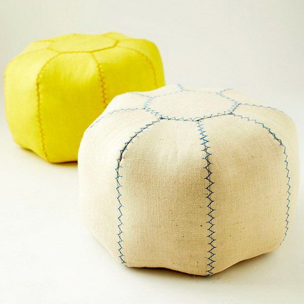 Sew This DIY Pouf. Cut the pieces and stitch the sets, press the seams, join the pairs, put all haves together, fill all fabrics inside for the pouf, baste top and bottom pieces, add the decorative stitch to finish this pouf off for your fantastic dorm room decor for girls.