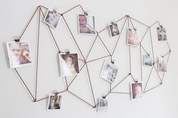 DIY Geometric Photo Display. Use bronze jewelry cord to create a stunning background to display all your photos. Use little binder clips to attach all your pictures. It's so great to decorate your dorm room in this fantastic geometric decor and display your sweet memories.