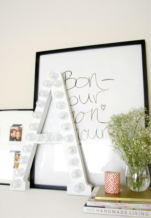 DIY Marquee Letter. Cut along the letter from the cardboard, cut an asterisk to push the bulb, twist the lights into place to tuck excess cord. It serves as a fashionable decor for your dorm room and gives off elegant illumination as well for girls.