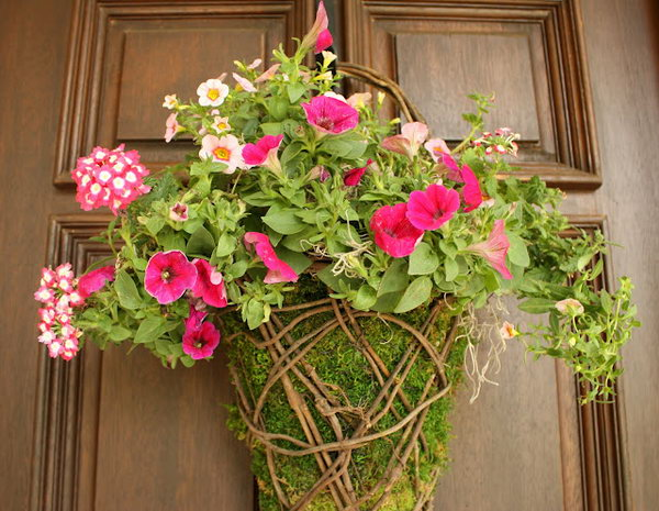 Easy Front Porch Moss Basket. Fill the moss basket either with dried stems or fresh flowers. Stuff the basket to completely cover the part that you see from the front of the basket. Just insert half of the flowers in to the last top third of basket for a beautiful rustic design for May.