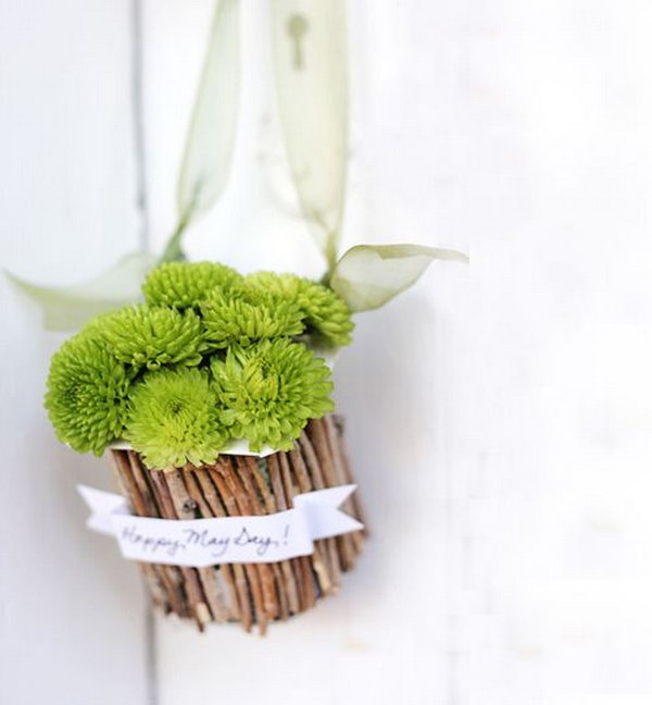 May Day Baskets. Snap twigs to the size of your yogurt container, glue message banner over sticks, add the ribbon, flowers and hang it on to create a sweet and fresh natural decor to surprise all your friends and family members.