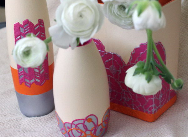 DIY Textured Clay Vase. Use puffy paint to draw or trace your design, paint your vase and spray with sealant and you'll get this lovely textured, clay like vase. Just display your pretty spring blooms to show off this floral sets.