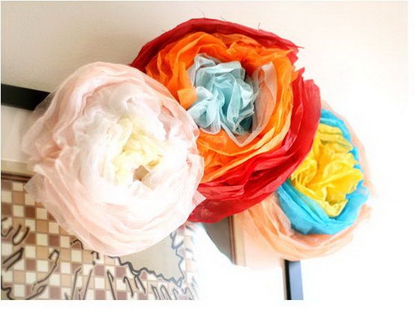 DIY Festive Paper Flower. Fold the stack of tissue paper of 3 colors. Staple the center part to secure. Scrunch it up to form circular curves to form the flower petal shape. It's super chic to arrange them as a beautiful bouquet for decoration display in May to impress all your friends and relatives.