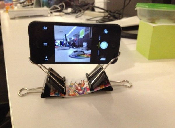 This phone stand with binder clips and a business card is pretty cool.