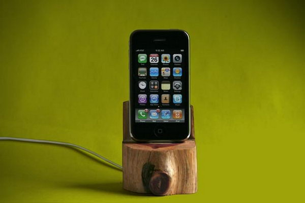 Tree Trunk iPhone Dock. As its name suggests, this iPhone dock features a stand made out of the trunk of a small tree. The iPhone display visual effect is just so fantastic.