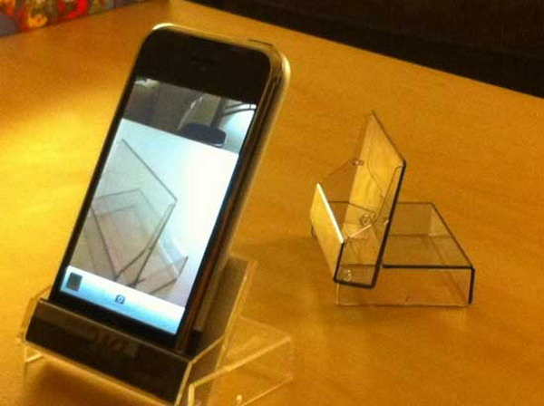 Mini DV Case iPhone Stand. Take advantage of mini DV case to make this iPhone stand easily. It can be served as earphone carrier as well. It's easy to make yet it has various functions.