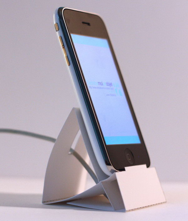 Paper iPhone Dock. Just download and print out the template for this paper iPhone dock. Set up your iPhone dock from the folded cardstock. It's easy to make yet very useful to display your iPhone device.