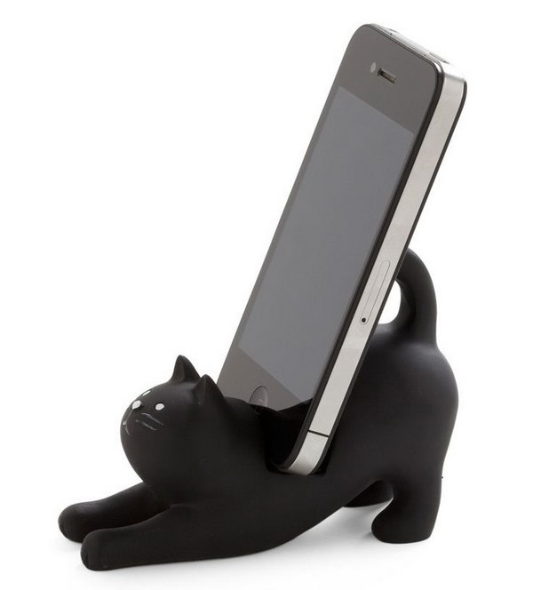 Charming Black Cat iPhone Stand. This functional cat stand can hold your smartphone upright with a notch on its back and cute curled tail to display your device in a playful and funny way.