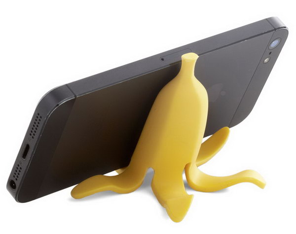 Banana Appeal iPhone Stand. It's super chic to display your iPone or other devices from slipping off your desk with this banana peel iPhone stand. It features bright yellow peels and notched front to prop up your iPhone reliably.