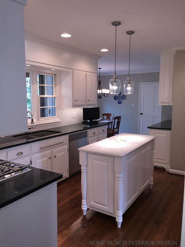 Small white traditional kitchen. The island was beautifully made and looks very elegant. The integrated island feet add a traditional feel to this piece. The island paint color is also Benjamin Moore OC 17 White Dove.