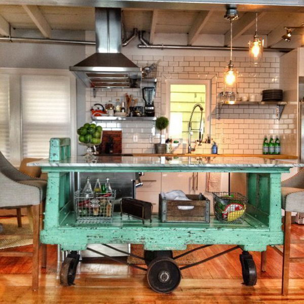 Vintage Factory Cart. Movable green vintage island here is absolutely a great way to pop the whole space. And the  cast is really a separate serving space that allows you to  entertain with drinks.