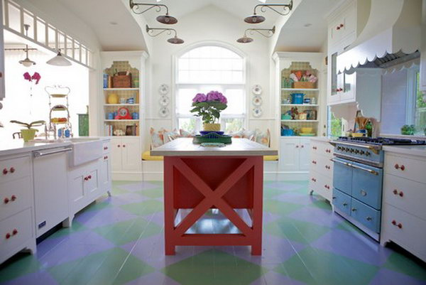 Coral colored island. This chic cottage kitchen is really a different one. Every detail is  elaborately made. White kitchen, painted wood floor, red island, blue range...beautiful!