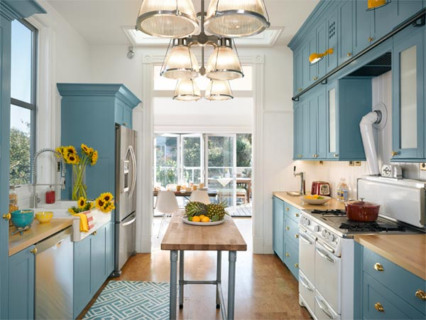 Bright Kitchen. Opened Up To The Sun, The Galley Kitchen Is Now Blue And