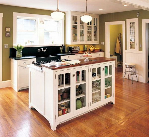 Island combines stove and storage.This custom made movable kitchen island with plate rack and stove not only offer original storage strategies, but also offer a convenient display opportunity and keep the room from feeling confined.
