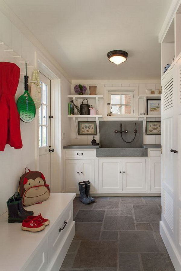 Keep the mud from the room  you can wash off before you come in the house! Pretty floor eccoes the marble countertops. And there are so many cabinets to put in your shoes and other stuff. I'm in love with the cute shelves and hooks.