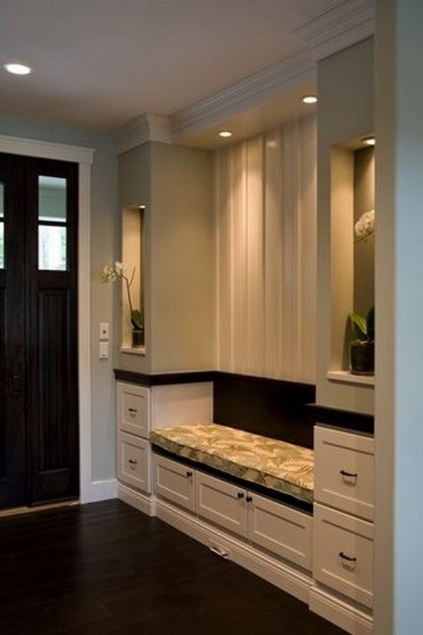 Elegant mudroom. Symmetry is utilized everywhere in interior designing and it can create a space easy to eyes. And the contrast between black and white is also very classic and beatiful that is keeping hot.