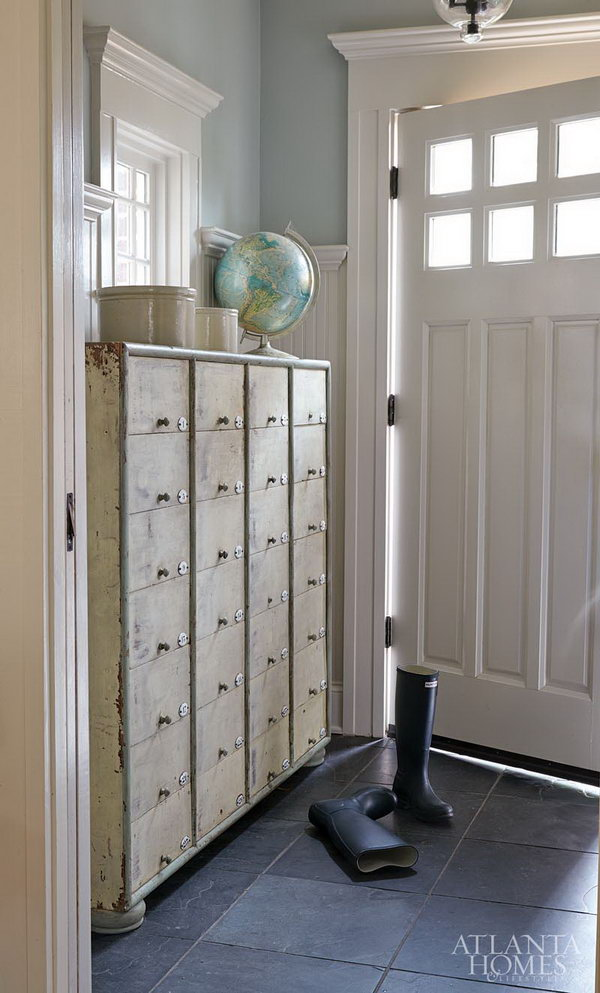 Old boutique cabinet. This mudroom is perfect for each house coastal entryway, love the layout of somthing old and something new. It's a incredible bright spot to make this blue and white space stand out....Love the storage possibilities!!