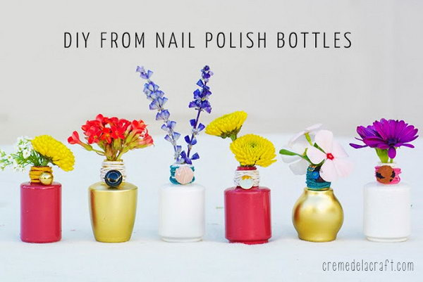 DIY Mini polish bottle vases. This is the perfect way to recycle old nail polish bottles you have lying around. These mini polish bottle vases are the amazing addition to your living room.