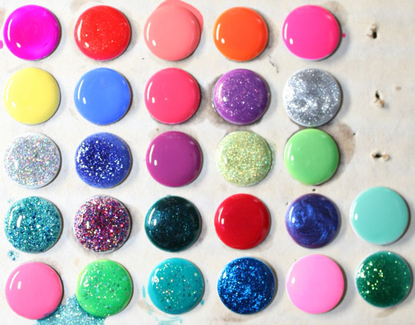 DIY Polished Push Pins. Use your new spring colors set of nail polish to create some glitter and colorful push pins.