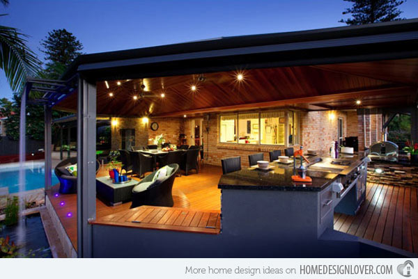 The open plan and the lighting design of this outdoor kitchen make it look luxurious and gorgeous.