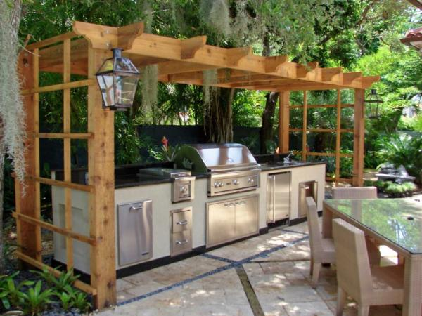 Everything Looks So Harmony In This Wooden Outdoor Kitchen Surrounded By The Greens It Is