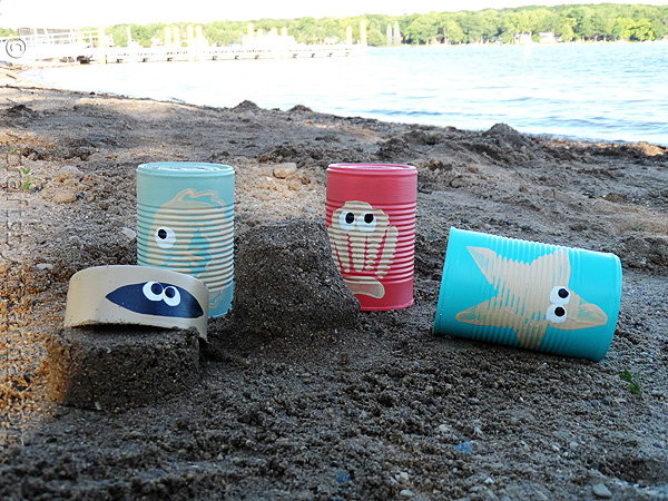 Sea Creature Sand Castle Cans. Just paint the stamps and press them onto the recycled vegetable cans, you can create these funny sand castle scoops easily. They can used to scoop and dig sand and make castles in summer. Or you can place pencils and markers inside for the rest of the year.