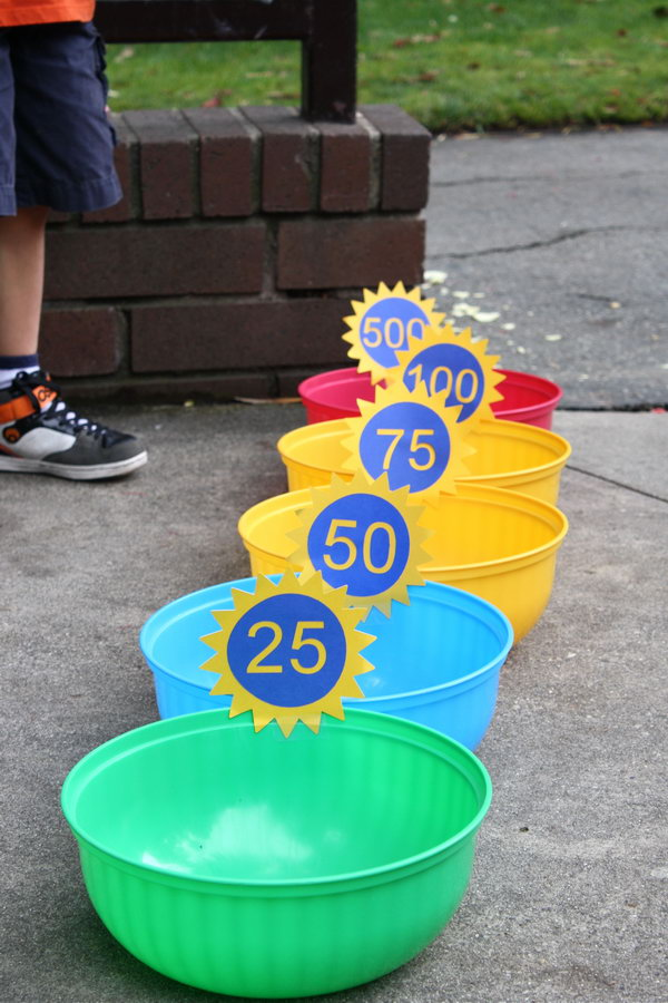 Bean Bag Toss. Place bowls from the dollar bin from target. Ask kids to take turns to throw the bean bags into the bowls. You can specify scores for different bowls and count the winner. It's easy for kids to play in this funny way.
