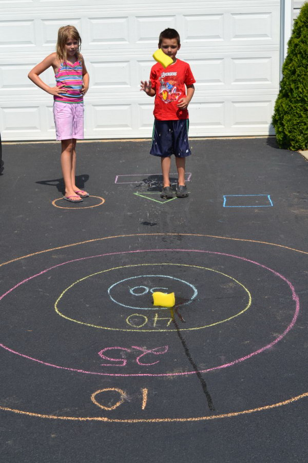 Sponge Bullseye. Draw a bullseye and assign score for each circle of the target. The kids toss their sponge at the starting line. It's great to train your kids' throwing accuracy in this funny way in summer.