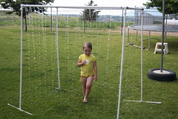 PVC Pipe Sprinkler. Prime your pieces and cement them into place. Drill random holes and turn the hose on as high as you can for the strong water stream. It can't be cooler for your kids to walk through on a hot summer day.