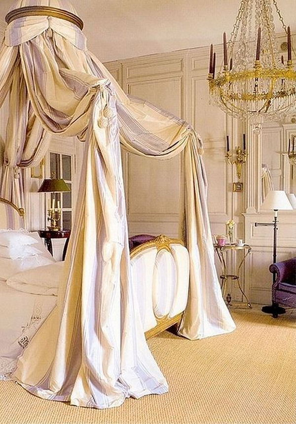Breathtaking Master Bedroom: The soft lavender striped crown canopy, the perfectly ornate chandelier and elegant wood-panelled walls, the scallop-trim linens and luxurious gilded bed — so many beautiful details