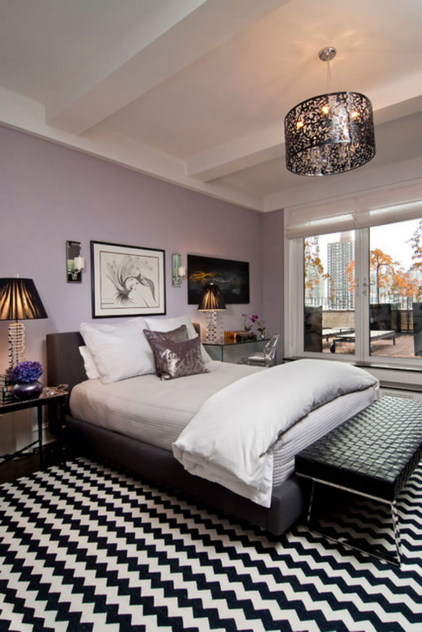 Purple and Black: The purple works with the black, Notice all the details :Beautiful Light Fixture, the ceiling, mirrored tables, wallpaper color,  furniture pieces,  the iced mauve with black and white rug  isn't so overwhelming.