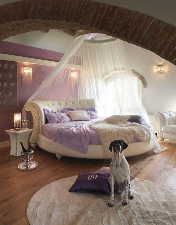 Modern Purple Bedroom: There is so much I love about this room, the colour, the brick arch, the unique bed shape, the nightstand, the lighting and all.