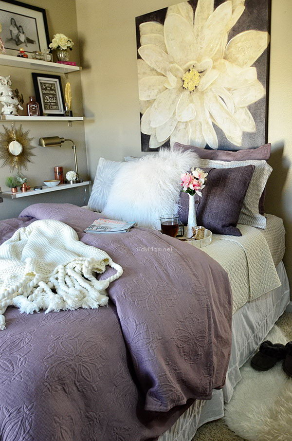 Purple Wall Art: The oversized wall art and curtains used in this bedroom is a tricky way to accent the pastel feel of this bedroom.