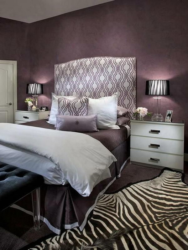 Nice Headboard And Zebra Rug Accents: This Bedroom Oozes Glamour With Its Mix Of  Purple Hues