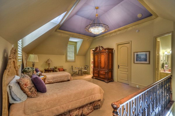 Clever Purple Ceiling with Gold walls: How fanciful and carefree. The colors in it are comforting. I like the high ceiling and how it is painted the same purple as a pillow on the bed and they add class to this bedroom. The railing is also great!