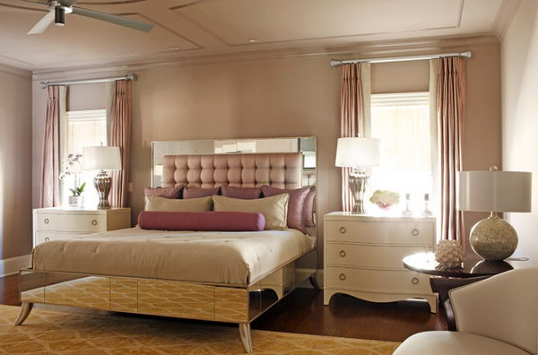 Mauve Master Bedroom: The color Mauve is used through out the space and transcends the word glamour to create a truly masterful retreat which  matches the drapery and bed upholstery.  The custom bed with a luxury headboard is the show piece that anchors the two ivory lacquered chest.