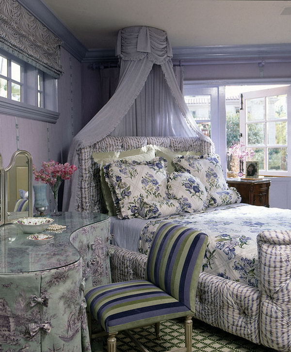 Fairy Tale Like Bedroom: It's a gorgeous space that could read both romantic and elegant. Let's check out the details: the colors and the curtain hanging above the bed, the table,  the angle of the bed, the fairy tale like furnishing, the bedding. And they work together to feature a space that is beautiful, and so inviting.