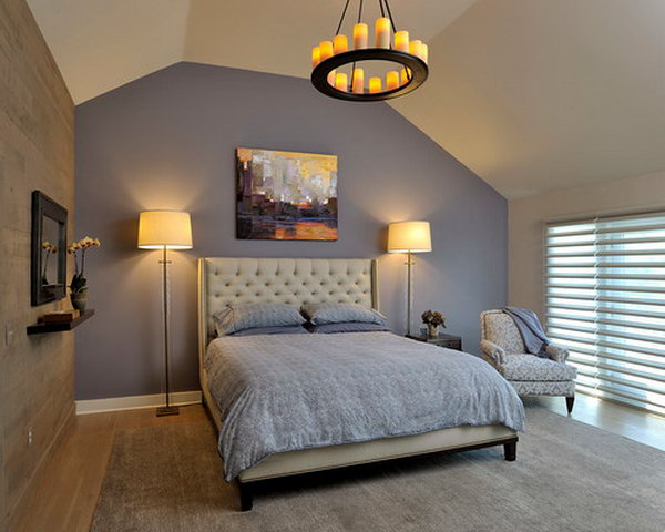Benjamin Moore 2118-40 'Sea Life':Purple as an accent wall behind bed... adds drama to the tufted linen headboard and original art. Tall glass lamps complement the headboard and ceiling height. Candle chandelier adds ambiance.