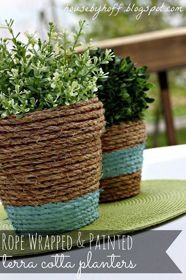 Rope Wrapped Plant Pots. Wrap rope around some cheap terra cotta pots and added a touch of left over paint. The result is a cute outdoor centerpiece! See tutorial for full details